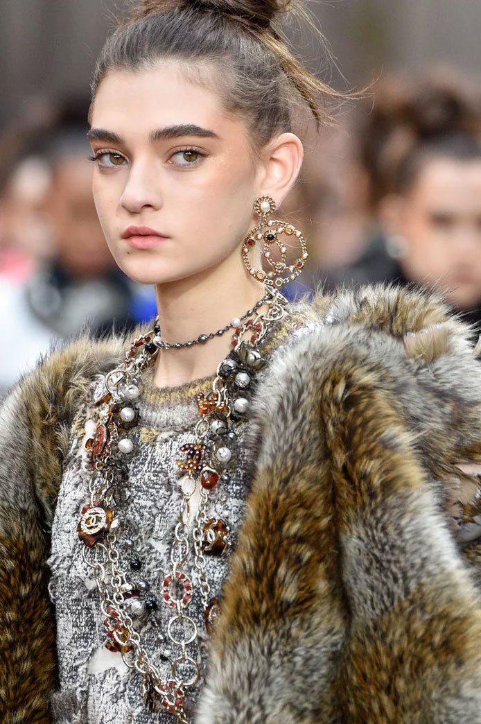 Logo earrings at Chanel