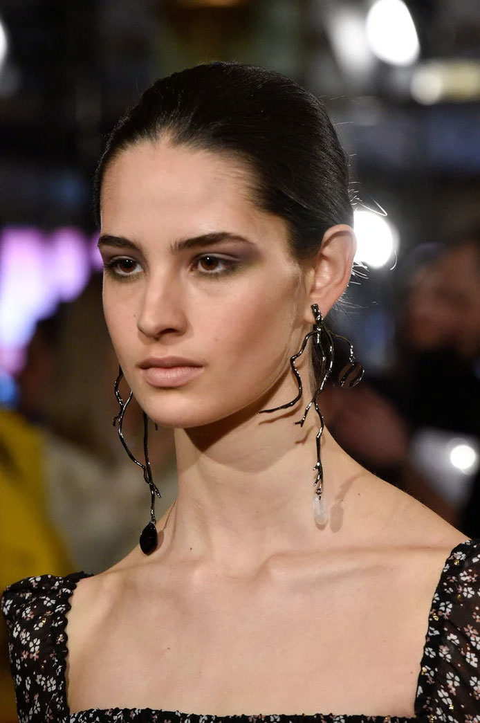 Statement earrings at Altuzarra